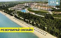 Нощувка на база All inclusive в Ikos Oceania Resort 5*, Неа Мудания, Халкидики