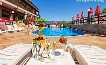 Нощувка, закуска и вечеря + открит минерален бесейн и джакузи в СПА хотел Аспа Вила, с. Баня, до Банско