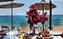 На ПЪРВА ЛИНИЯ в Гърция! Нощувка със закуска в хотел Angelos Garden, Tорони,  Халкидики