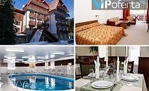 Делнични и уикенд пакети за двама възрастни + дете със закуски и вечери, отопляем басейн в Хотел Иглика Палас**** Боровец