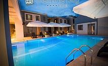 Лято на първа линия в Микри Мантиния, Гърция! Нощувка със закуска + басейн от хотел Mantinia Bay****