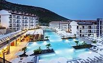 Майски празници в Дидим, Турция! 5 нощувки на човек на база All Inclusive + басейн, аквапарк и СПА в хотел Рамада Резорт Акбук, Дидим. ДЕТЕ ДО 13Г. - БЕЗПЛАТНО
