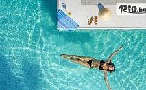Майски празници в Нея Потидея, Гърция! 3 нощувки със закуски и вечери в Portes Lithos Luxury Resort +  открит плувен басейн, шезлонг и чадър на плажа, от Мисис Травъл
