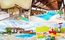 Майски празници в село Баня до Банско. 2, 3 или 4 нощувки на човек със закуски и вечери + минерален басейн и релакс пакет в хотел Севън Сийзънс
