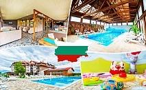 3 Март в село Баня до Банско. 2 или 3 нощувки на човек със закуски и вечери, едната празнична с DJ + минерален басейн и релакс пакет в хотел Севън Сийзънс