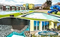 Нощувка на човек + 3 открити басейна + 2 външни джакузита + сауна и парна баня с минерална вода в Комплекс Европа***, Долна Баня