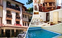 Нощувка на човек със закуска, обяд и вечеря + минерален басейн и релакс зона в хотел Емали, Сапарева Баня