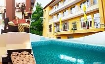 Нощувка на човек със закуска, обяд и вечеря + минерален басейн и балнеопакет в хотел Божур, с. Минерални Бани, край Хасково