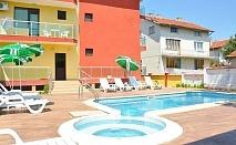 Нощувка на човек със закуска и вечеря + външен, вътрешен басейн и релакс зона в хотел Жаки, Кранево
