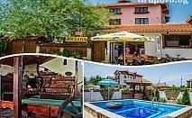 Нощувка със закуска или закуска и вечеря в хотел Крайпътен рай, с. Баня до Банско