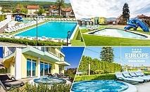 1 или 2 нощувки на човек със закуски + открити басейни + външни джакузита + сауна и парна баня с минерална вода от Комплекс Европа***, Долна Баня