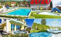 Нова Година в Долна Баня! 3 нощувки на човек със закуски + Новогодишна вечеря с DJ + 3 открити басейна + 2 външни джакузита + сауна и парна баня с минерална вода от Комплекс Европа***