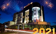 Нова година в Луковит! 2 или 3 нощувки на човек със закуски и вечери, едната празнична в ресторант Атриум + басейн и СПА зона от хотел Дипломат Плаза****