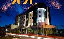 Нова година в Луковит! 2 или 3 нощувки на човек със закуски и вечери, едната празнична в ресторант La Plaza + басейн и СПА зона от хотел Дипломат Плаза****
