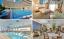 Пакети със закуска и вечеря + БОНУС НОЩУВКИ, Лечебен басейн и СПА в Гранд Хотел Поморие 5*