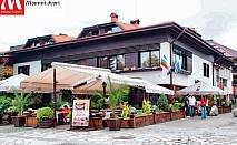 Почивка в центъра на Банско! Нощувка със закуска и вечеря за двама или трима от хотел и механа Момини двори
