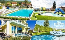 Почивка в Долна Баня! 1 или 2 нощувки със закуски за ДВАМА + открити басейни + външни джакузита + сауна и парна баня с минерална вода от Комплекс Европа***
