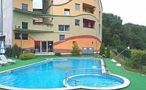 Почивка в Хисаря! Нощувка за двама или четирима + външен басейн и джакузи с минерална вода в Детелина