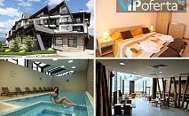 Празнични пакети в студио или апартамент със закуски и вечери + ползване на минерален басейн и сауни в Хотел Аспен Ризорт Голф и Ски, до Банско