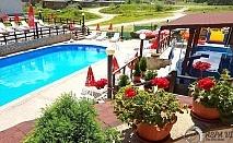 През Май в Хотел Аспа Вила, с. Баня, до Банско. Нощувка, закуска, обяд и вечеря + открит минерален басейн, джакузи и СПА зона