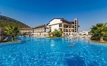 Ранни записвания за море в Турция! 7 нощувки на човек на база All Inclusive + басейн, аквапарк и СПА в хотел Рамада Резорт Акбук, Дидим. Дете до 13г. - БЕЗПЛАТНО!