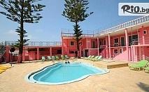 Ранни записвания за почивка на о-в Корфу! 4 нощувки със закуски и вечери в Pink Palace Beach Resort + транспорт, от Danna Holidays