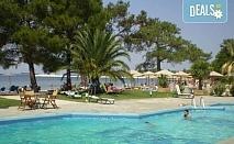 Ранни записвания за почивка на о. Тасос в период по избор с ТА Солвекс! 7 нощувки със закуски и вечери в Rachoni Bay Resort 3* в Скала Рахони, транспорт