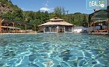 Релаксираща почивка в хотел Петрелийски 2*, с.Огняново! 1 или 2 нощувки със закуска и вечеря, ползване на закрит басейн с минерална вода, парна баня и сауна, безплатно за дете до 2.99г.!