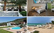 Тридневен пакет със закуски, вечери и великденски обяд + чадър и шезлонг на плажа в Хотел MARTI RESORT***, Тасос