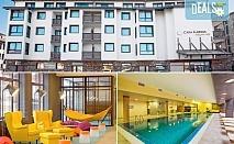 Великден в хотел Каза Карина 4*, Банско! 3 или 4 нощувки със закуски и вечери, празничен Великденски обяд, ползване на вътрешен басейн, парна баня и сауна, безплатно за дете до 5.99г.!