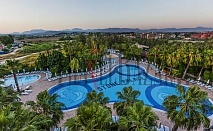 Vera Stone Palace Hotel 5*, Сиде. ALL INCLUSIVE. Собствен плаж, безплатно ползване на турска баня, сауна, мини фитнес, дартс, тенис на маса, плажен волейбол, аеробика, анимация, интернет.