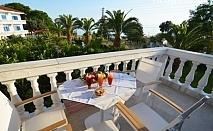Юни на 20м. от морето в хотел Paraktio, Неа Каликратия, Гърция! Нощувка в студио за двама, трима или четирима
